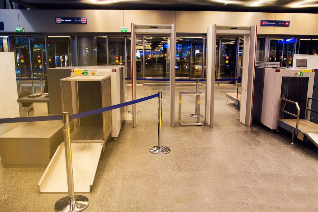 Checkpoint in airport. X-ray scan detector metal.